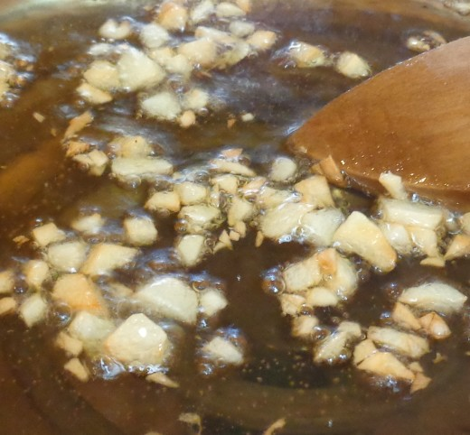 Browning garlic in olive oil