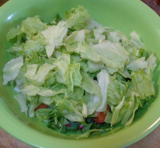 Adding lettuce to salad