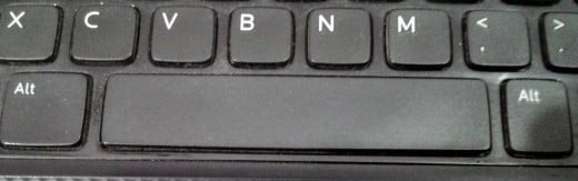 Alt keys - on either side of your Space bar