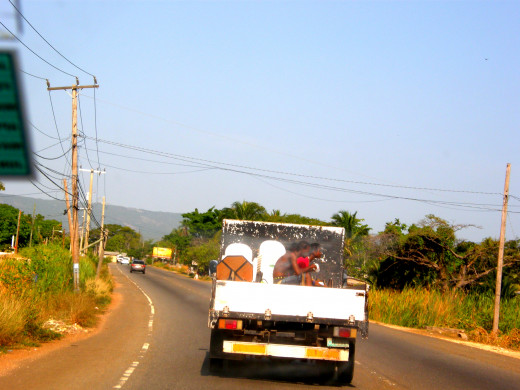 Riding in the back of the truck is not a strange sight to see in Jamaica.