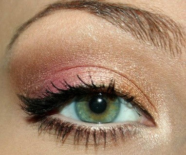 With gold, pink and winged eyeliner