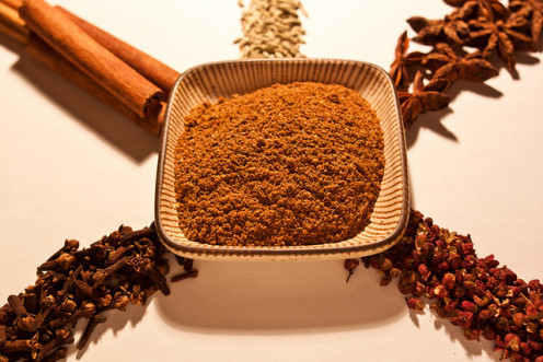 Chinese Five Spice Powder. Traditional: Sichuan peppercorn, cloves, cinnamon, fennel seeds, and star anise; clockwise from bottom right.