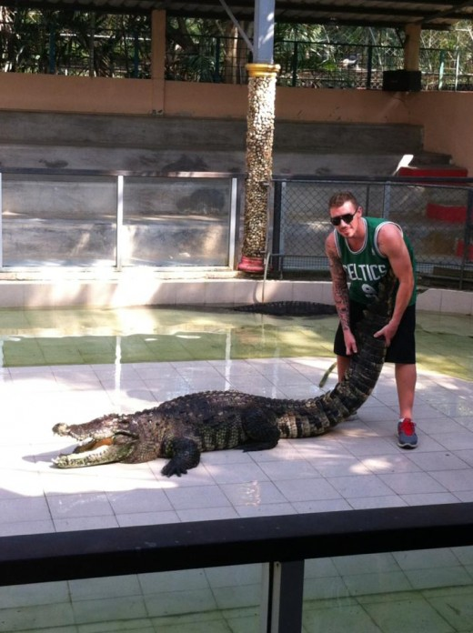 My son Trent getting aquainted with a crocodile, Thailand
