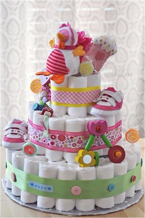 A nappy cake makes a great gift and centre piece for your baby shower