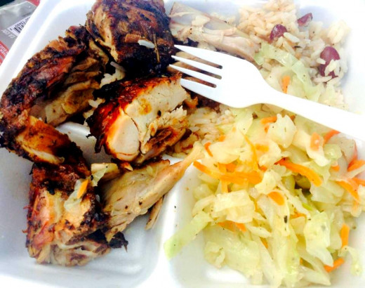 Jerk chicken, served with steamed cabbage and rice and peas