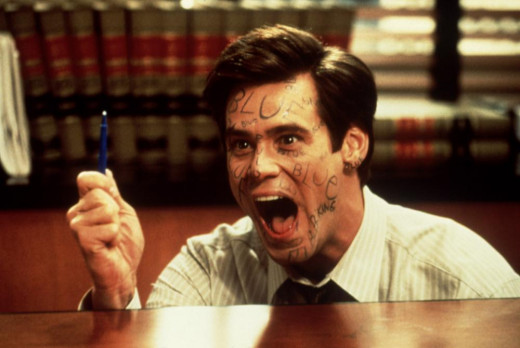Fletcher (Jim Carrey) desperately tries to lie that the pen isn't blue!