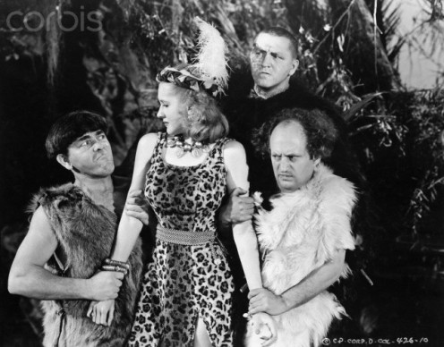 Jane Hamilton (center) and the Three Stooges seen in a jungle safari film.