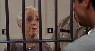 Greta (Anne Haney) visits her boss in prison.