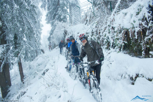 Moving in a single row on a trail.Riding starts once reaching the start line.