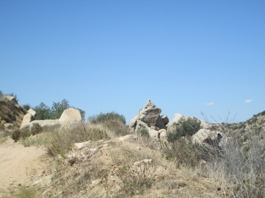 Many large boulders create various shapes. The viewer decides what these boulder formations represent.