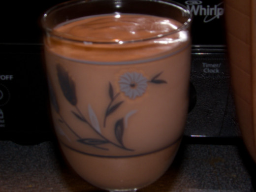 My daily shake, especially great for pms, includes whole milk, a banana, peanut butter, cocoa butter and spices.