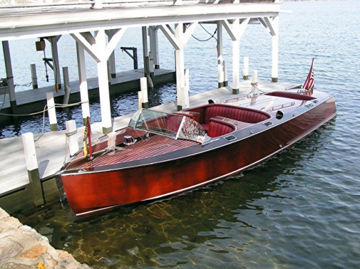 gorgeous wooden boat at the pier by the Hacker Boat Company