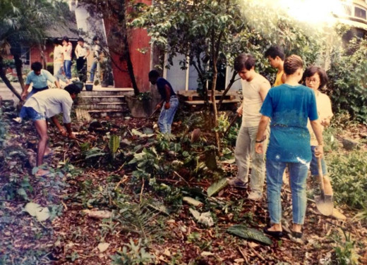 The group working to recover a small church that had been overgrown during the time Martial Law was in effect.