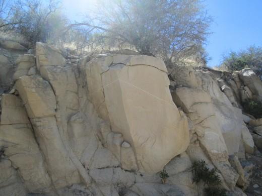 Line in a large boulder.