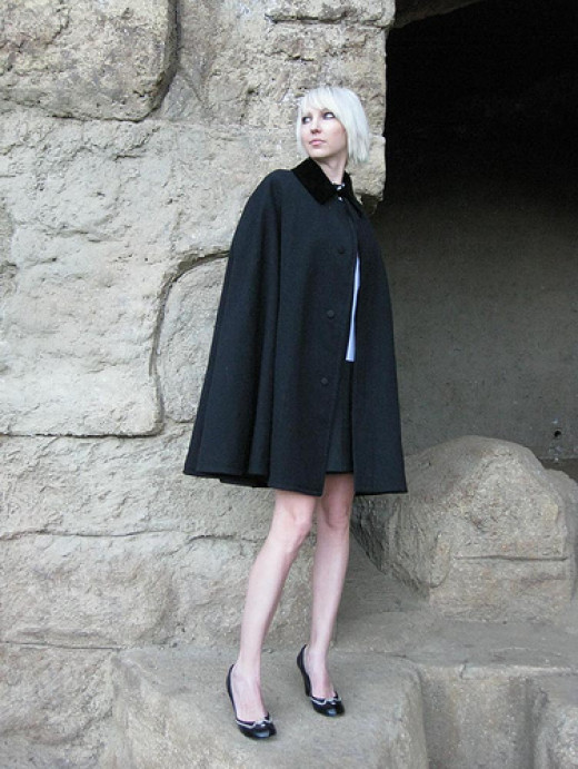 If you can find a black cape or poncho, you can line the collar or hood with black fur and have the exact replica of Mary Sibley's.