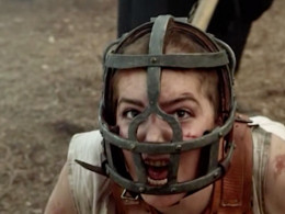 Mercy Lewis wearing the Scold's Bridle. You can make one of these out of leather pieces, scarves, etc. for an authentic Halloween costume.