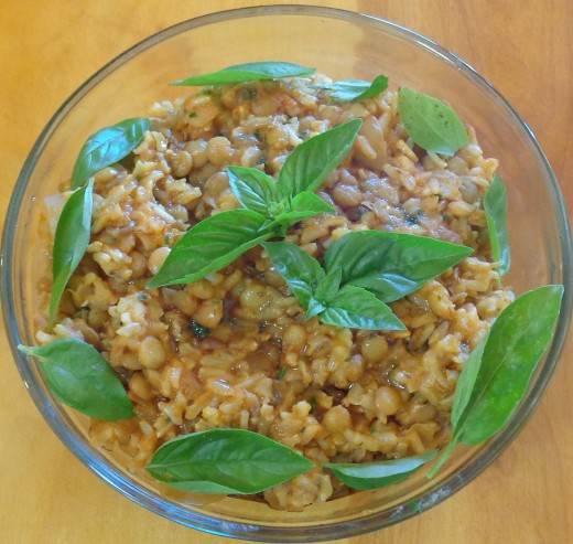 Rice and lentils garnished with fresh basil leaves