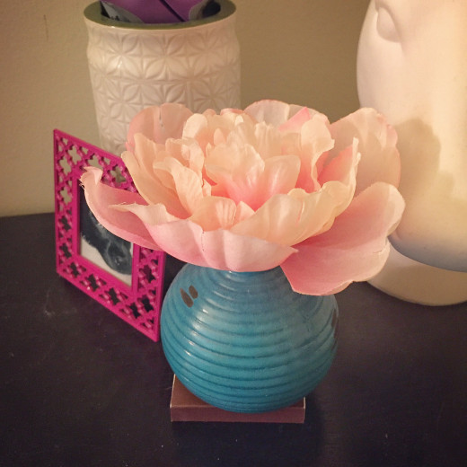 A cheap-ass little vase and tiny dollar-store flower ended up rull cute.
