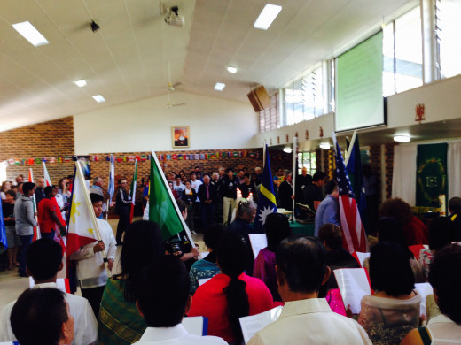 Flags of nations at the entrance procession during the multicultural mass at St Bernardine's Parish, Browns Plains, Queensland, Australia