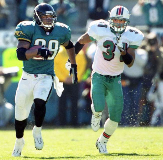 Fred Taylor running for a 90-yard TD against Miami in 1999
