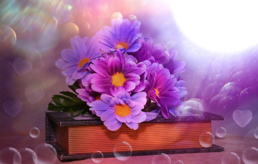 Artificial flowers on a book are an added decor feature. Wedding flowers on the Bible is another very popular theme.