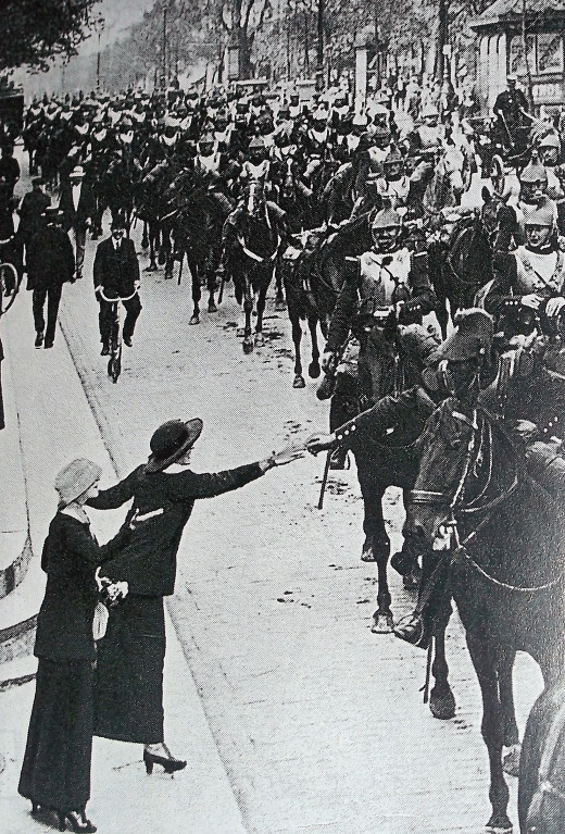 French women wave farewell to French soldiers leaving for battle