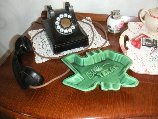 Rotary dial telephone from the forties, Texas-shaped ashtray and a lighter from the fifties