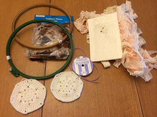 The supplies you'll need:  embroidery hoop, crocheted doilie, assorted ribbons, lace, and adornments