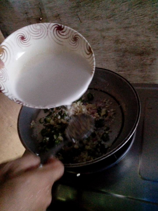 Adding body to the mixture is little amount of coconut milk, until half-done. Photo Source: Ireno Alcala