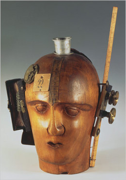 """Mechanical Head (Spirit of Our Age)"" by Raoul Hausmann. The sculpture is made from a hairdresser's dummy, parts of a pocket watch, pieces of a camera, tape measure and other objects."