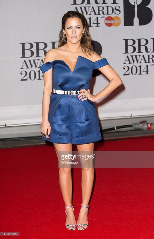 Actress Caroline Flack attends 2014 BRIT awards.