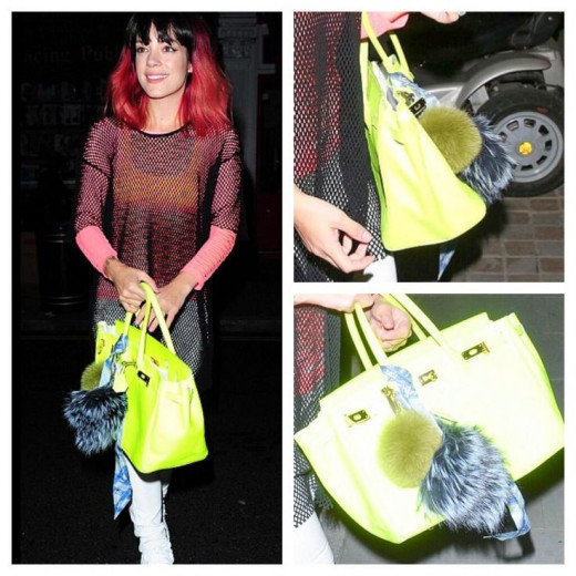 British singer Lilly Allen shows off three pom pom clipped to her handbag