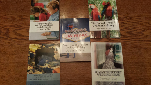 This is a photo of some of the books that this author has published using CreateSpace and Kindle Direct Publishing.  It takes patience, but anyone can use the same system to publish their own books at no cost to them!