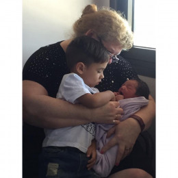 Cyrus being cuddled by proud Granny Kathy and big brother Taidan.