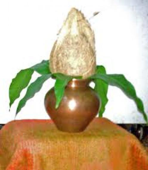 Mango leaves on Mangal Kalash for prayer purposes