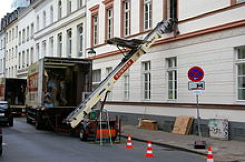 In Germany there is a contraption named a moving van and lift. This was taken in 2007 and shows a moving company getting furniture from the van to an upstarts apartment.