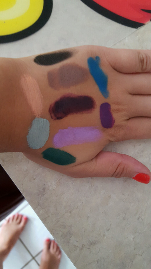 Lipstick Nick Palette swatches....the dark purple in the middle is the shade on my lips