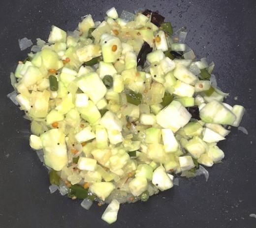Add ridge gourd pieces.