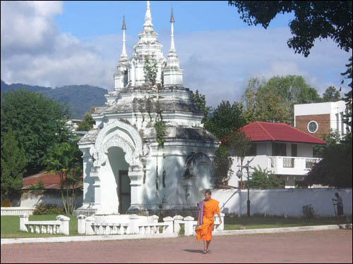 Temple and monk in the Chiang Mai Province in Thailand.