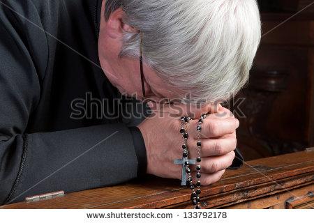Humble Priest Praying