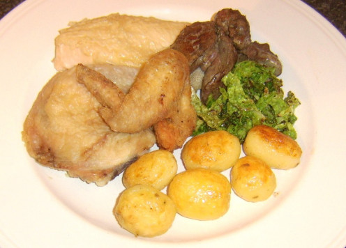 Chicken cooked four different ways with roast potatoes and savoy cabbage