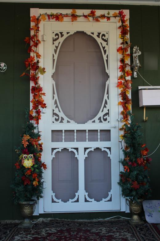 Entryways/doorways always look great with some garland and panache!
