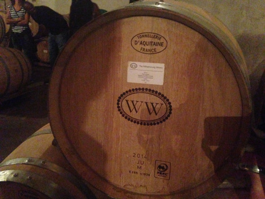 Each barrel has the Williamsburg Winery logo