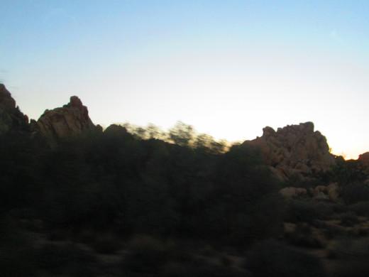 Boulders adorn the hillsides.