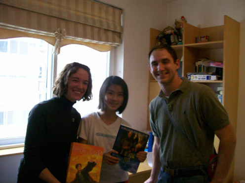 Me, Brenda and my husband. We are holding Harry Potter books, one of her favorite series.