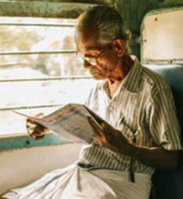 Bauji reading the newspaper