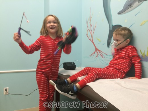 Let them wear what they want... if they are comfortable and happy, your visit might be also. Daughter is entertaining Son while he gets a breathing treatment.