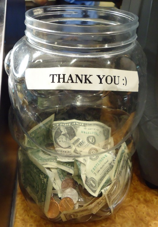 A countertop tip jar at a restaurant in New Jersey.