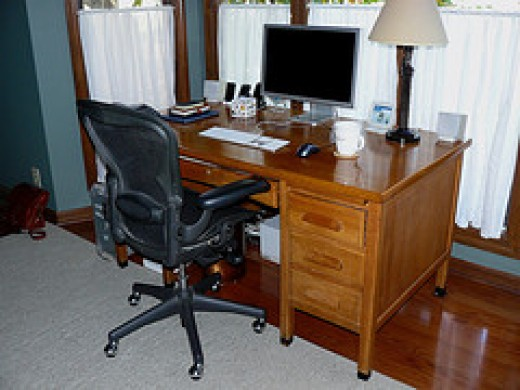 Great image of an oak office desk, with the computer and everything set up.