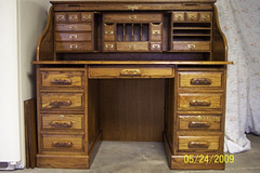 Great picture of an oak rolltop writing desk.